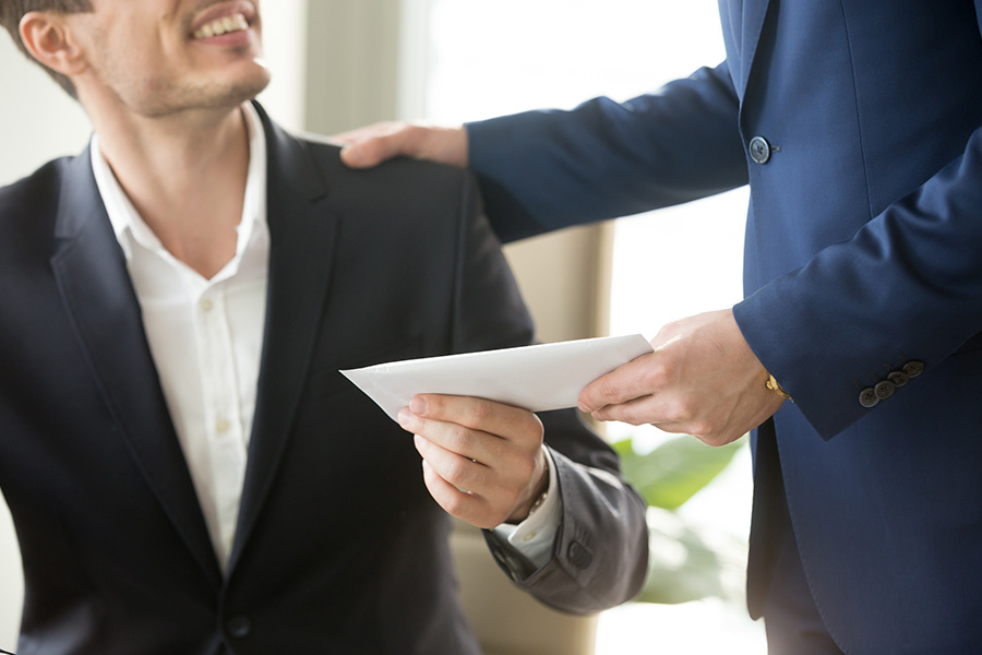A Gift For Your Business - Business Insurer and Client Shaking Hands After Accepting Small Welcome Business Gift